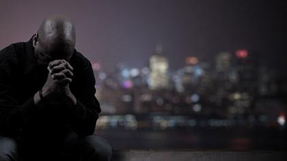 Man Praying For City